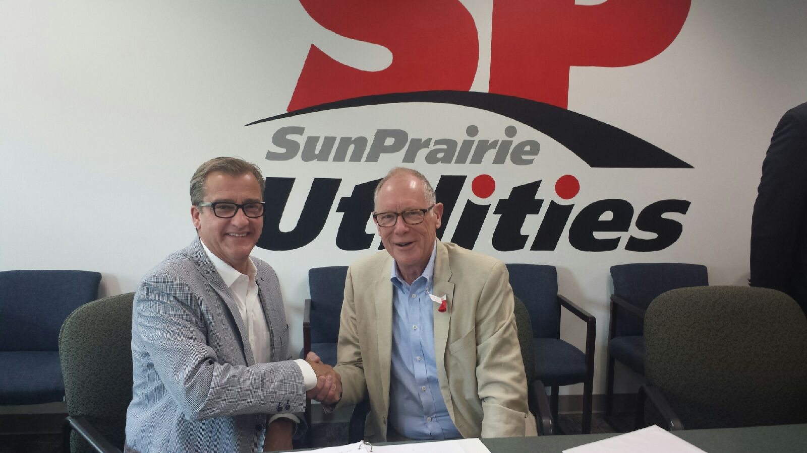Jim Butman, COO at TDS and Paul Esser, Mayor of Sun Prairie